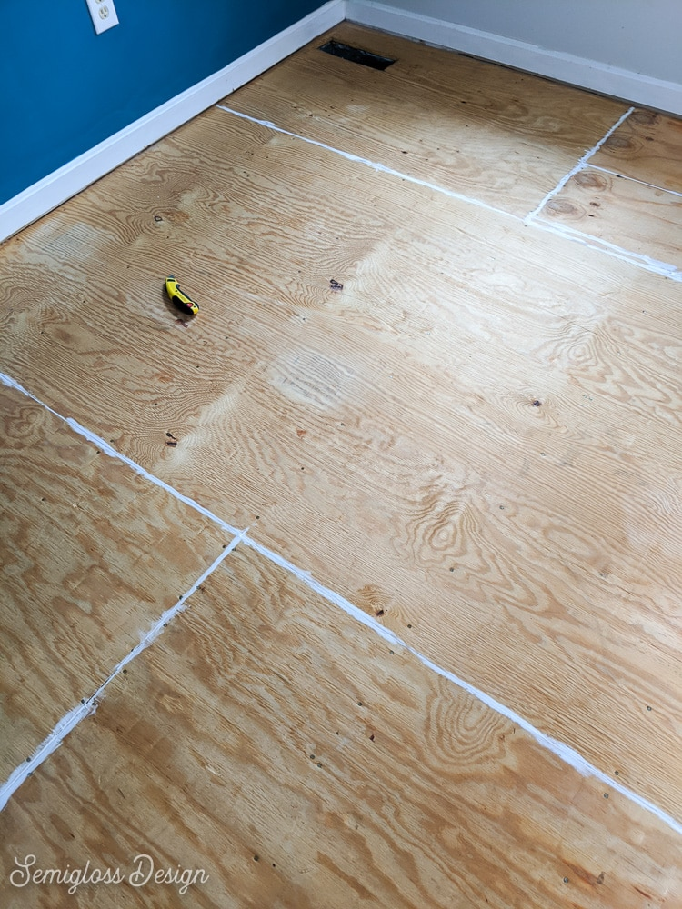 caulked seams of plywood floor