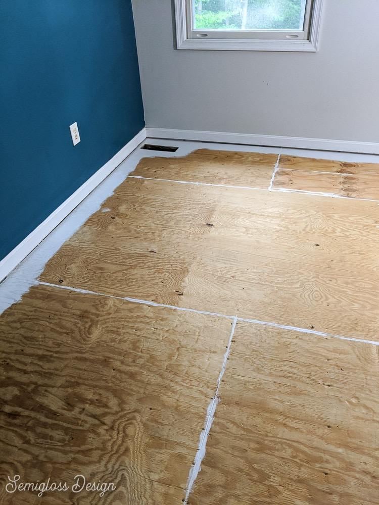 painting edges of floor in room
