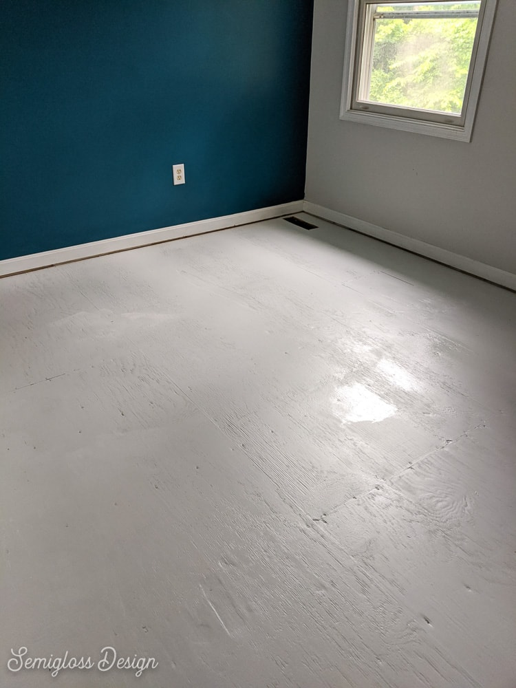 painting second coat of gray paint on floor