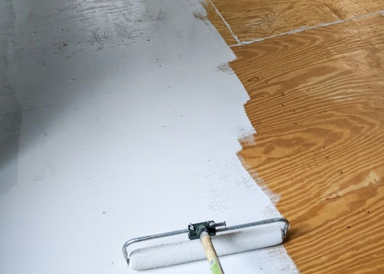 paint a plywood floor with light gray paint