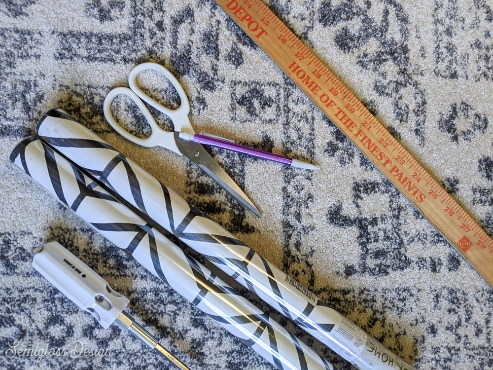 supplies for using peel and stick wallpaper on a dresser