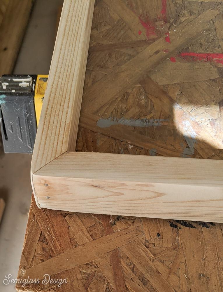 wood frame nailed together at corner