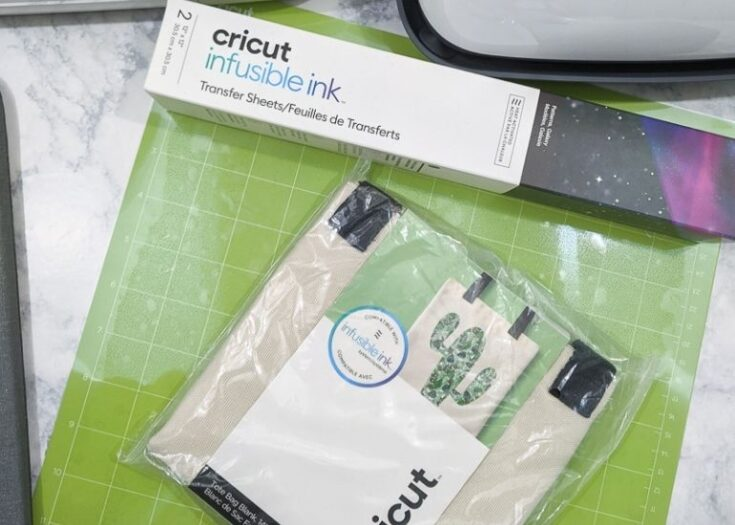 cricut infusible ink and tote bag package on green mat