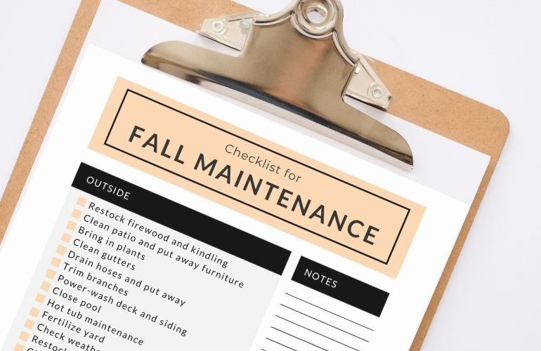 fall maintenance checklist on clipboard