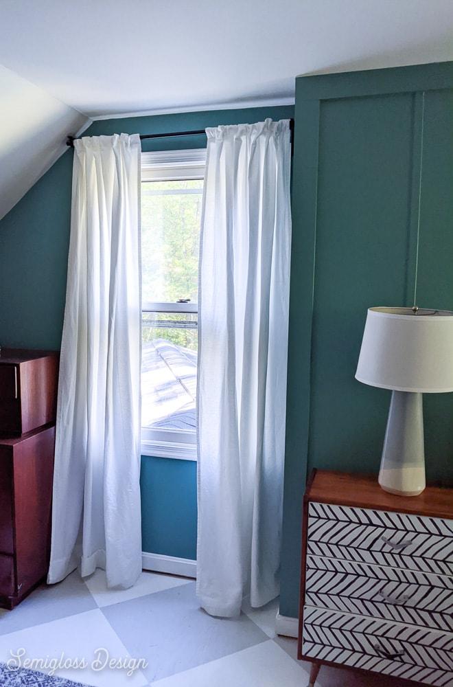 freshly hemmed curtains hanging