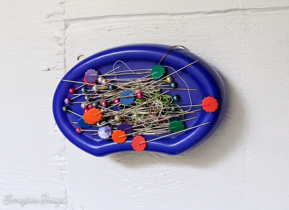 blue magnetic pincushion with pins