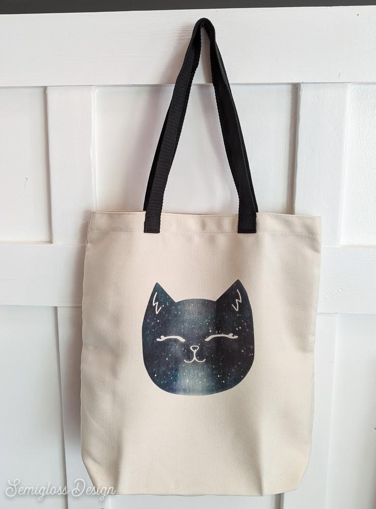 cat tote bag hanging against wall