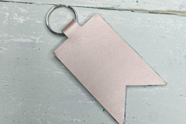 rose gold leather keychain in a flag shape