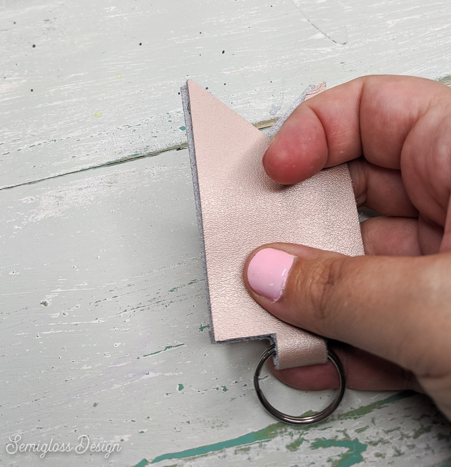 pressing leather onto glued surface