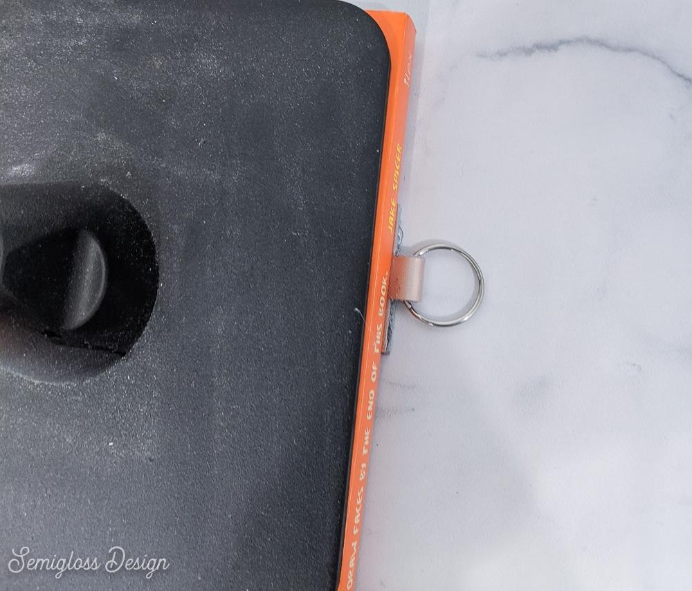 keychain under something heavy