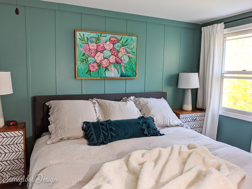 gray bed against teal walls