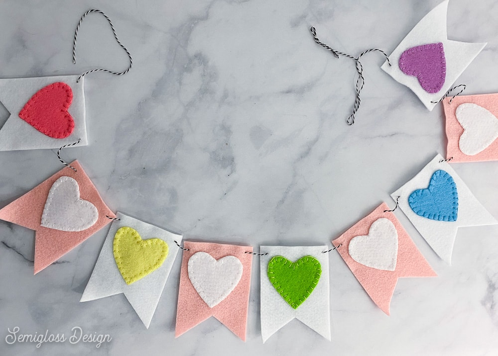 felt heart banner on marble background