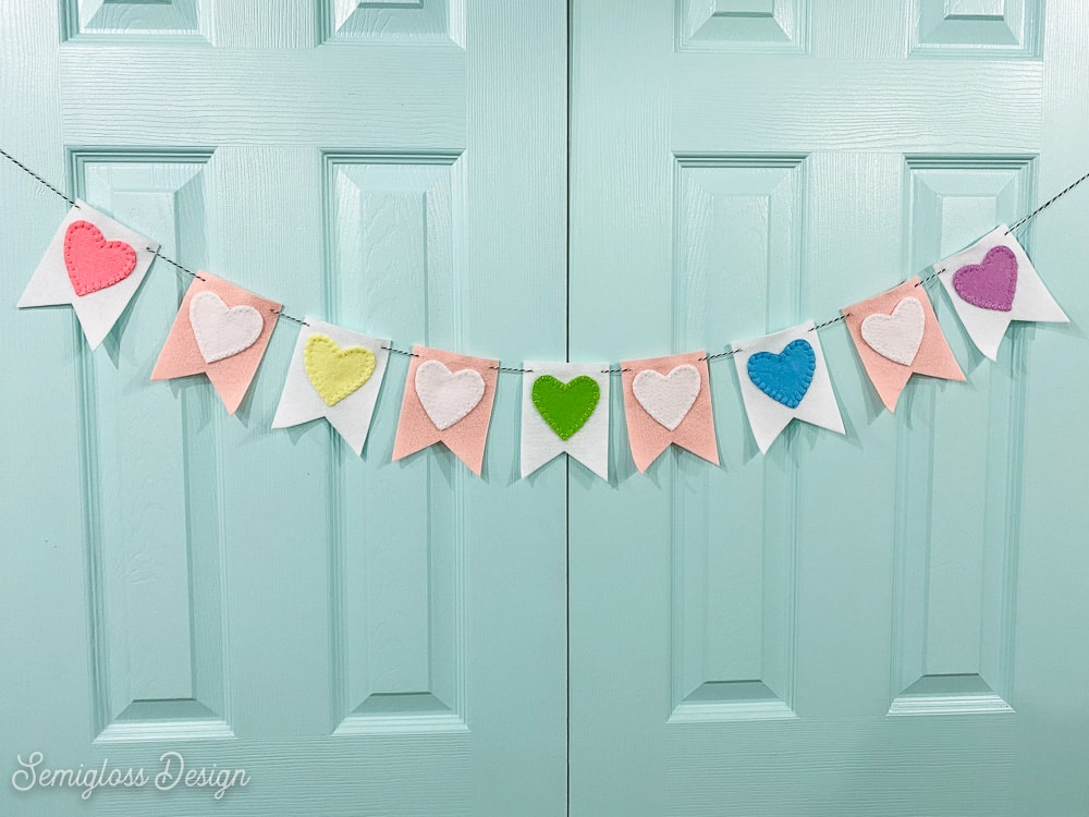 colorful felt heart banner on aqua doors