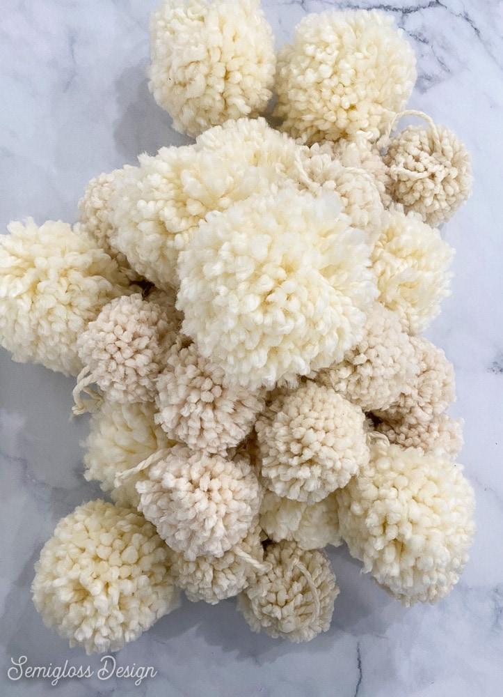 pile of white pom poms
