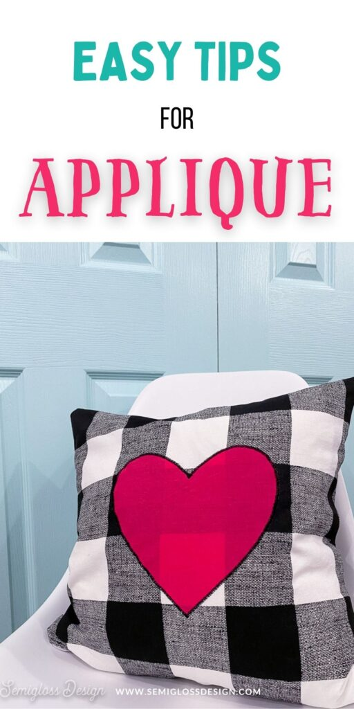 pink heart pillow on white chair