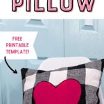black and white pillow with pink heart