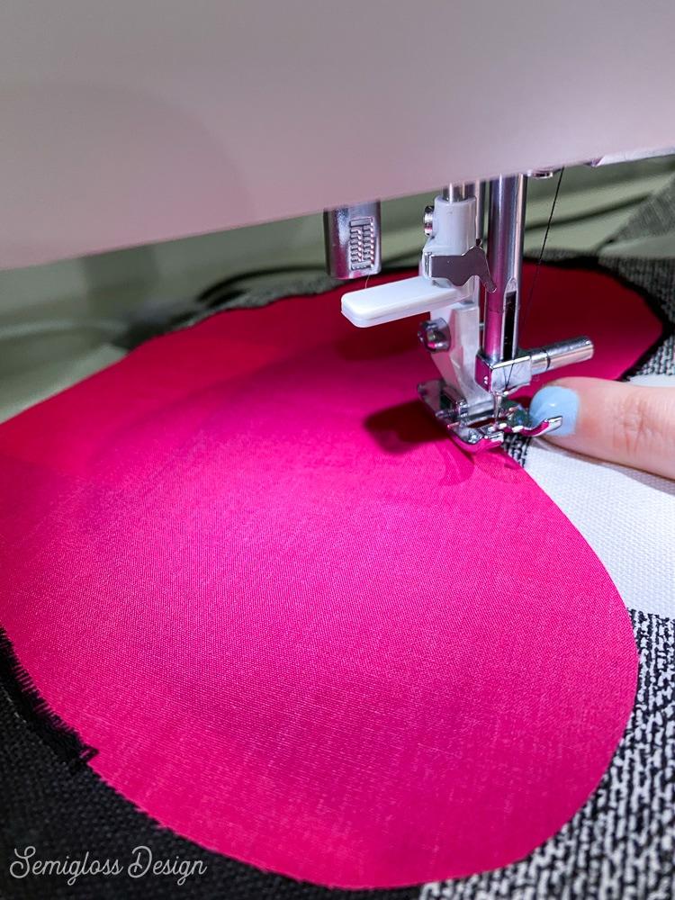 pivoting the fabric under sewing machine needle