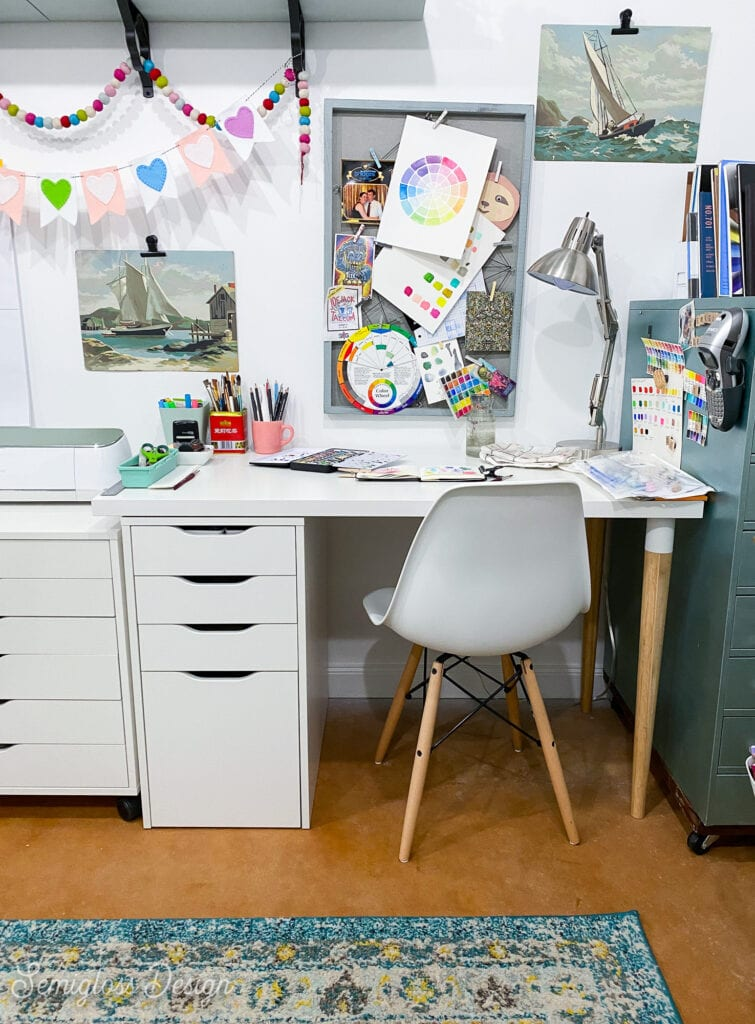 art desk with pinboard on wall