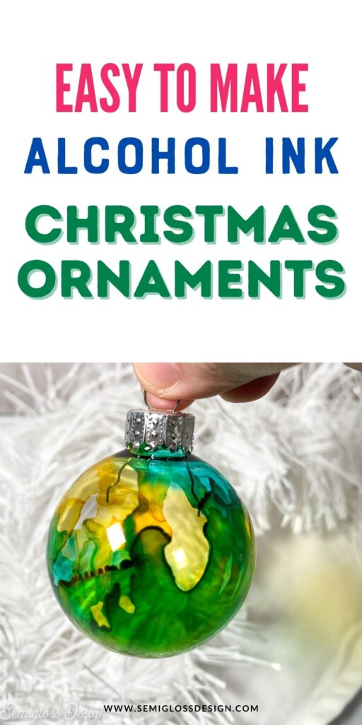 close up of green and yellow alcohol ink ornament with white tinsel in background