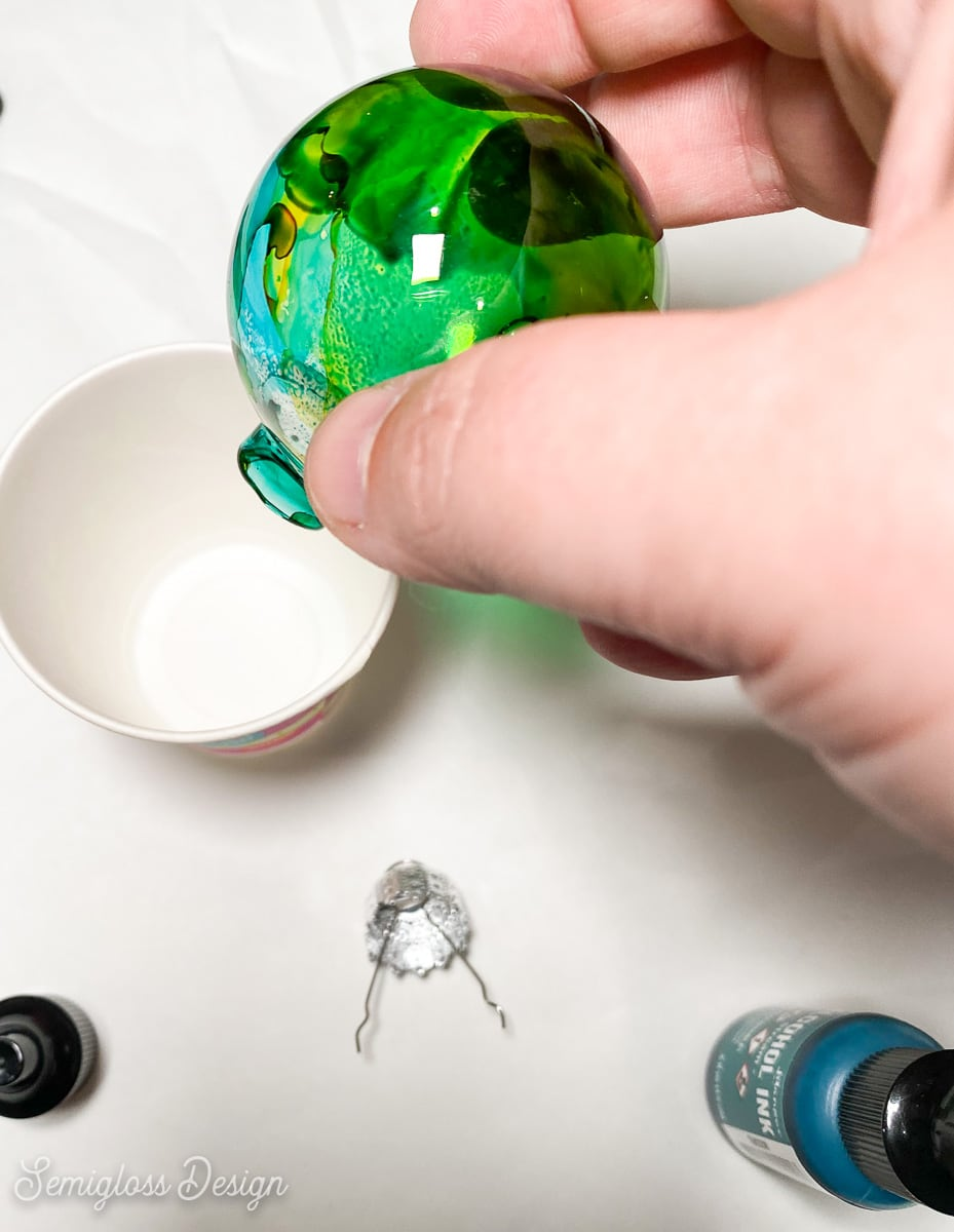draining excess ink into cup