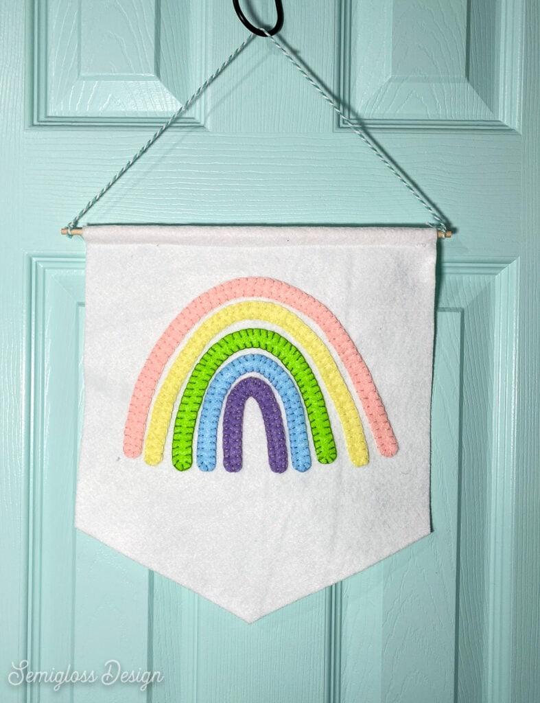 rainbow wall hanging on blue door