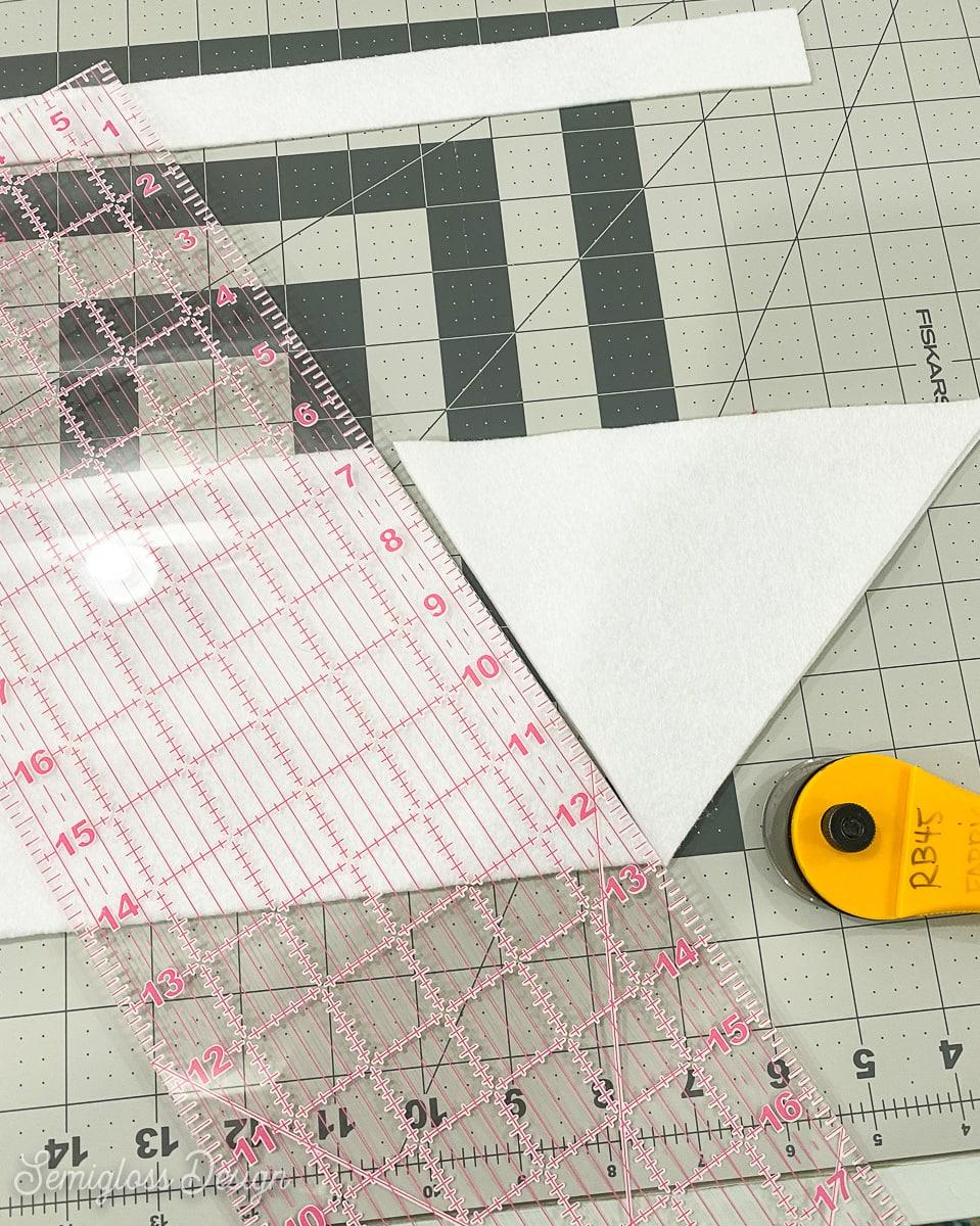 cutting angled shape on white felt
