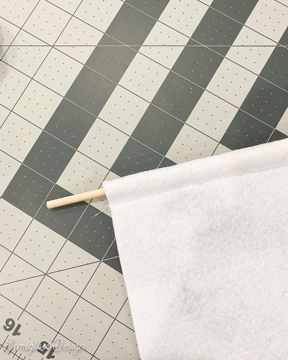 wooden dowel in channel in felt