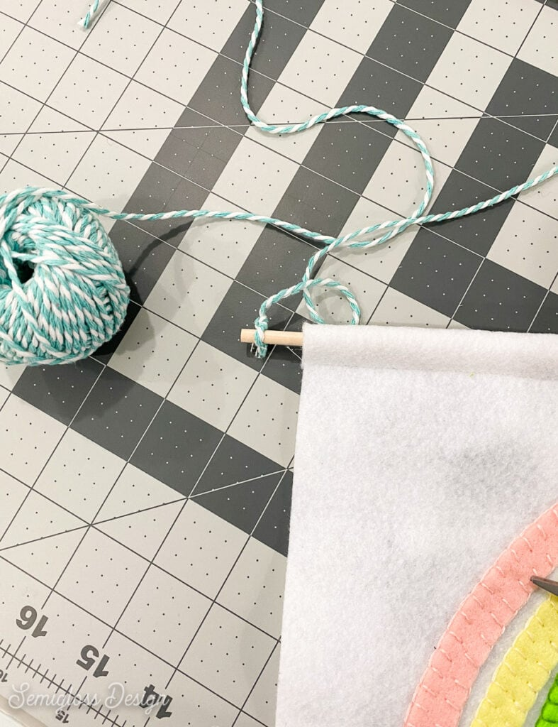 making hanger for wall hanging with bakers twine