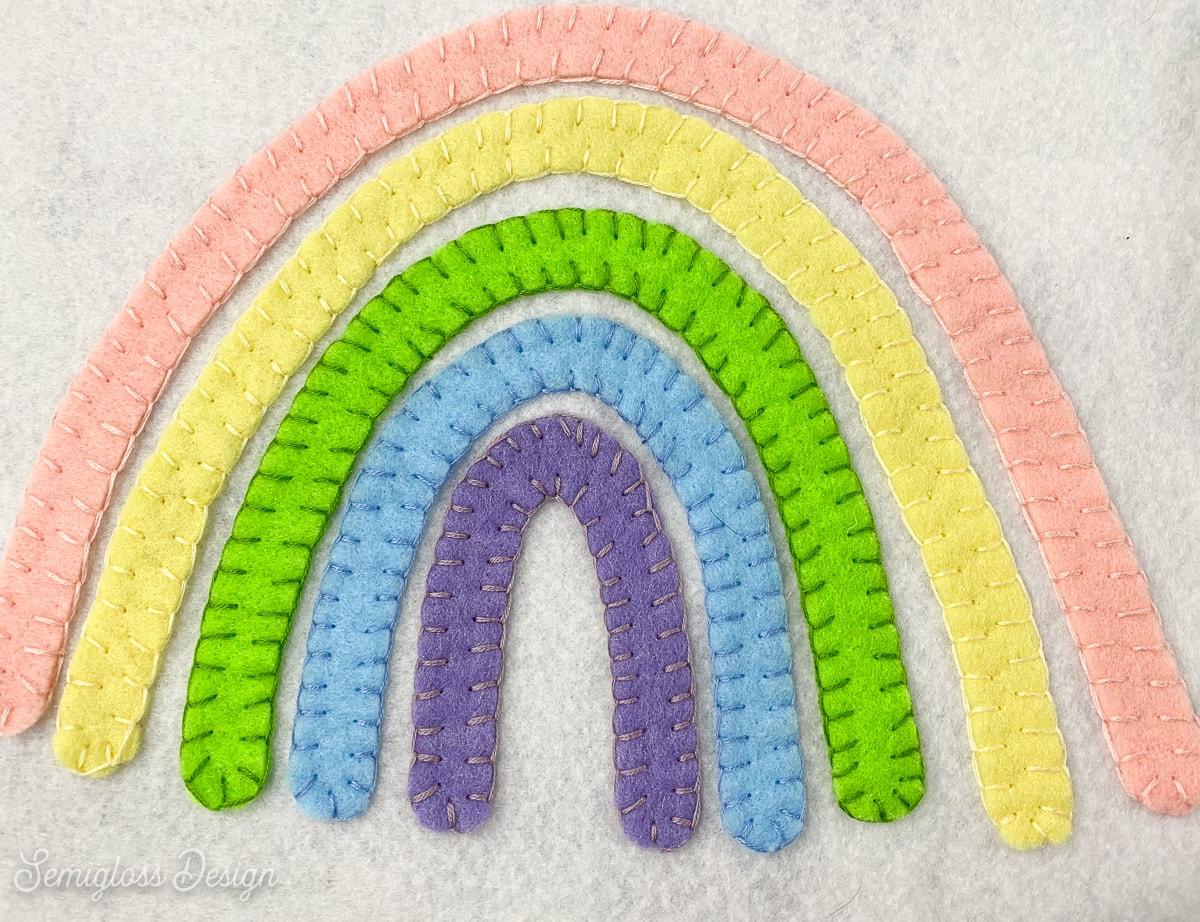 rainbow sewn onto felt with embroidery floss