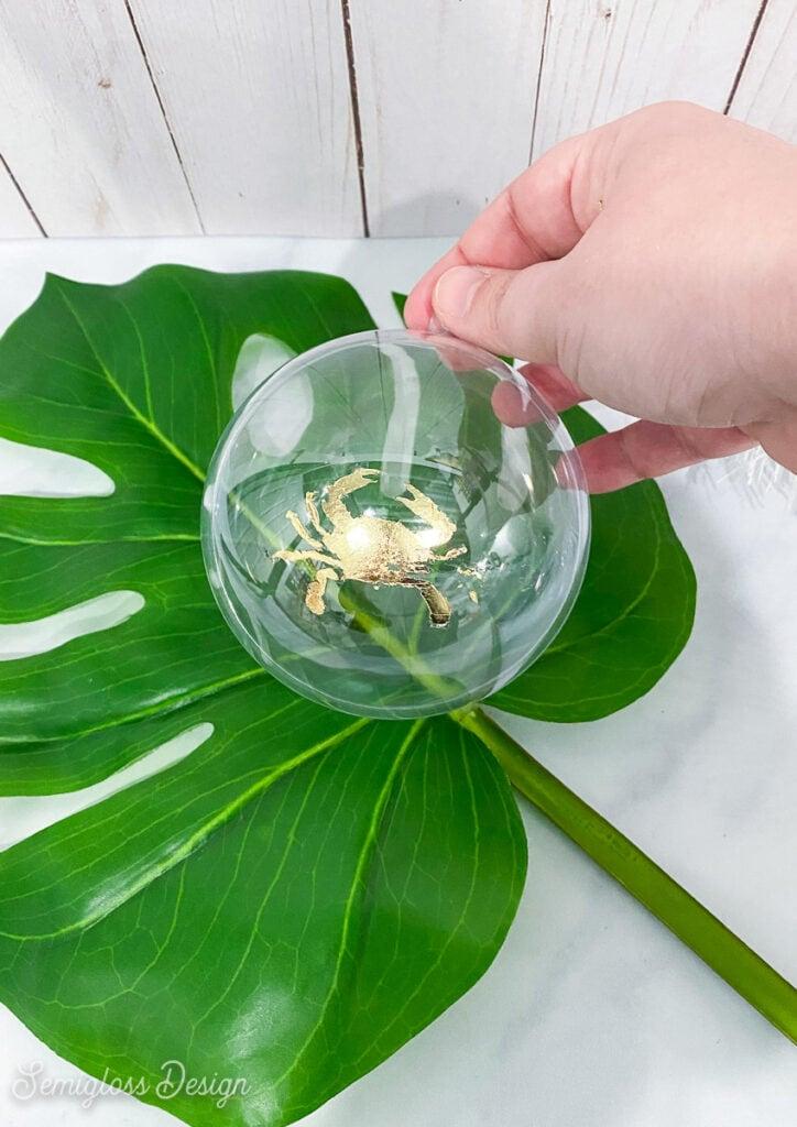 crab ornament on tropical leaf