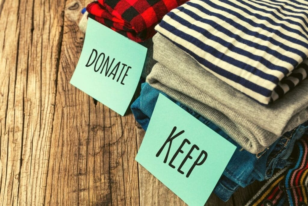 donate and keep piles of clothing
