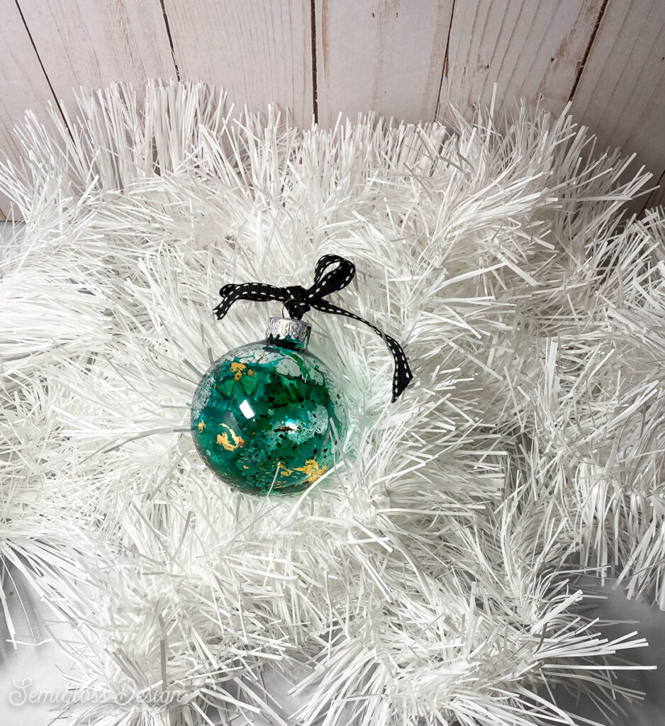 green ornament with gold leaf