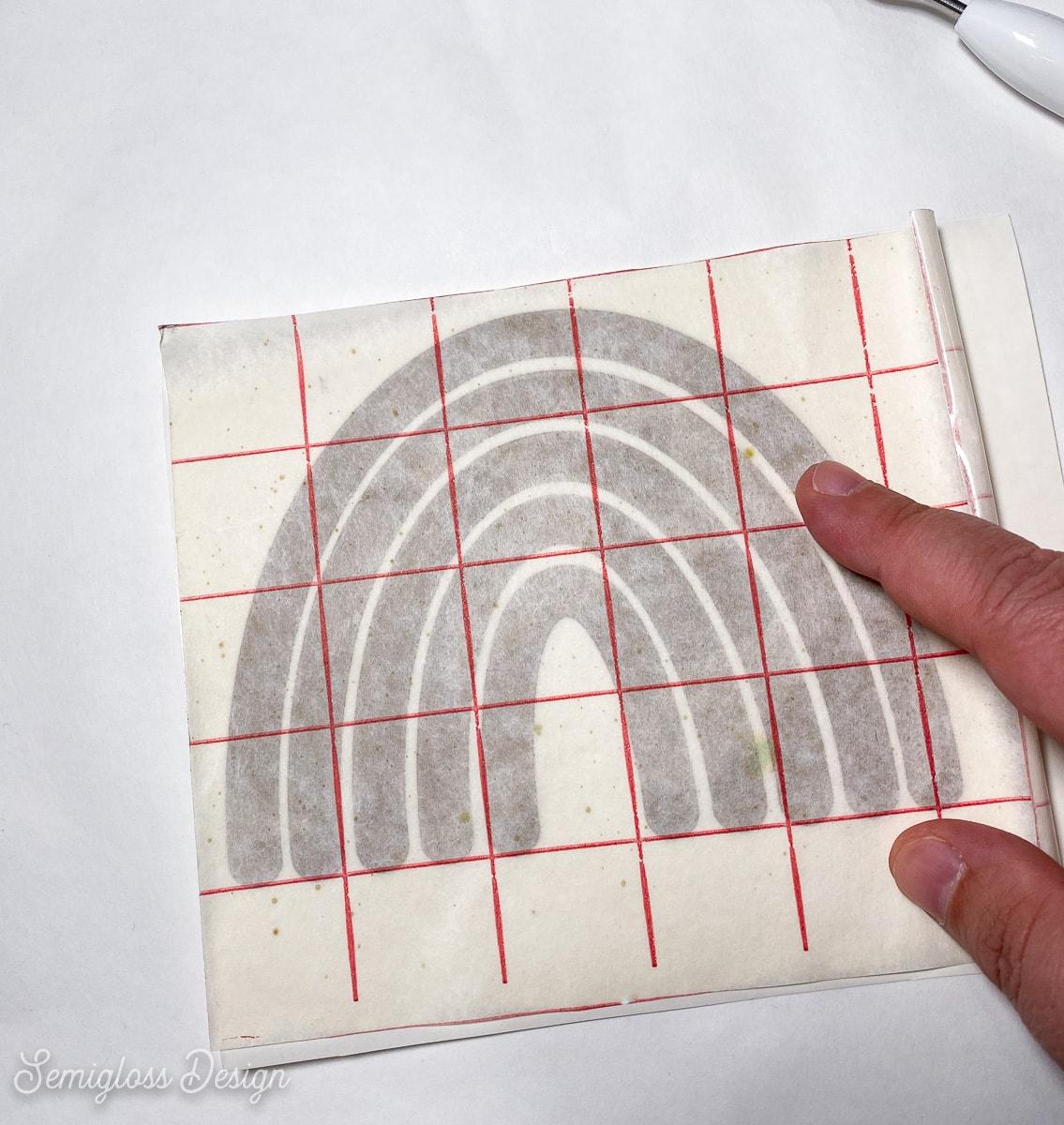 applying transfer tape to vinyl design