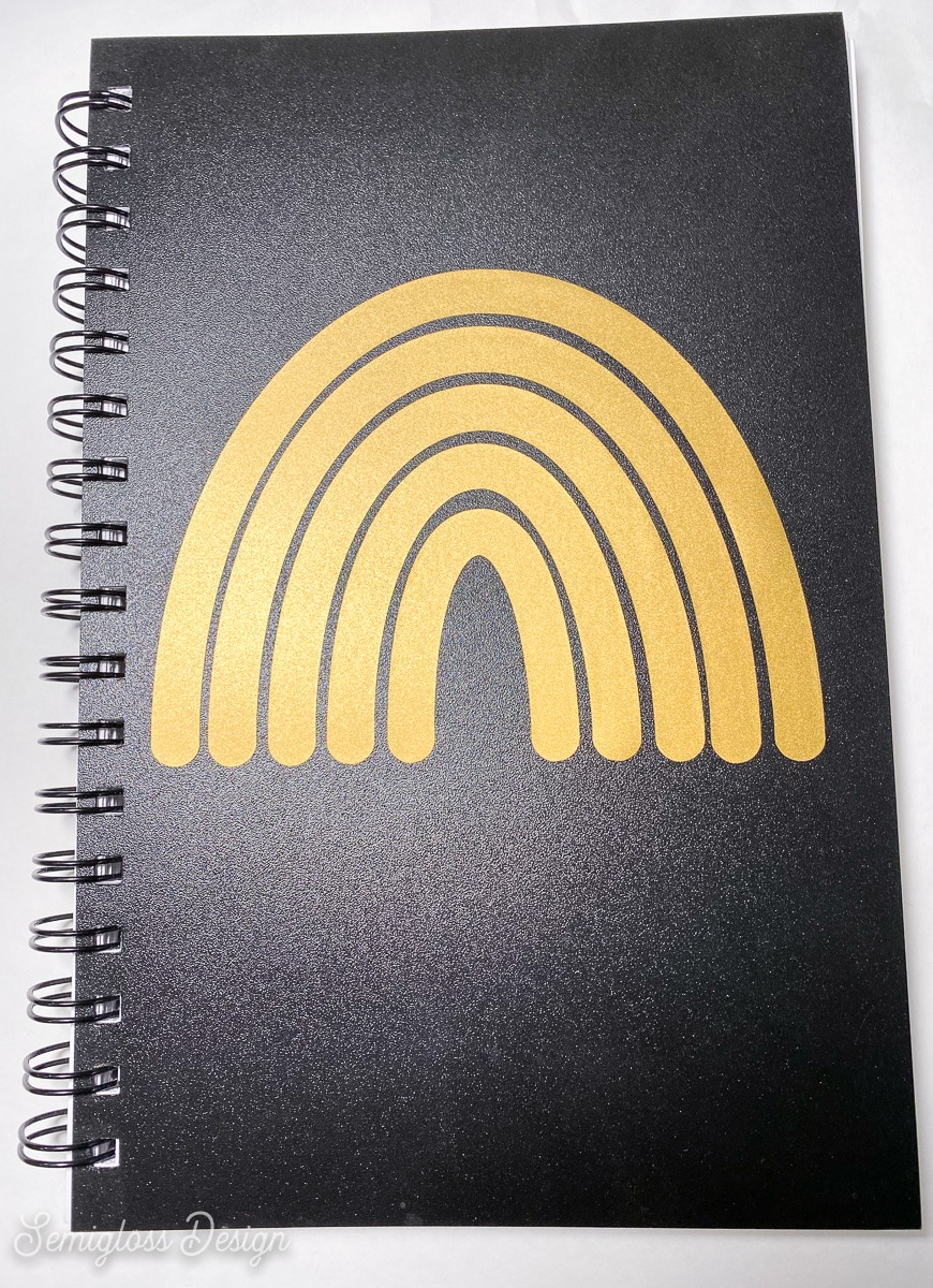 gold vinyl rainbow on sketchbook cover