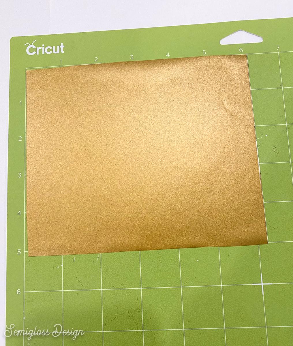 gold vinyl on green cutting mat