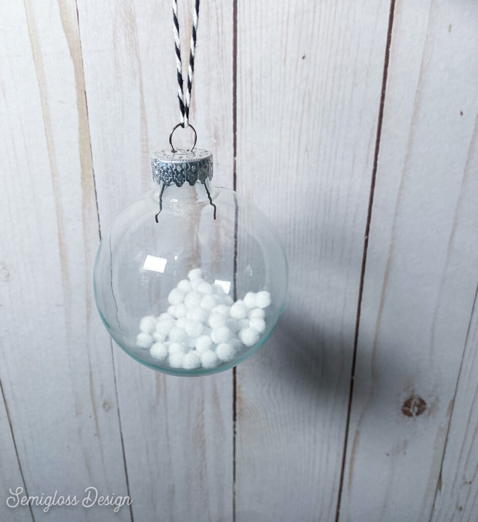 ornament filled with white fake snowballs