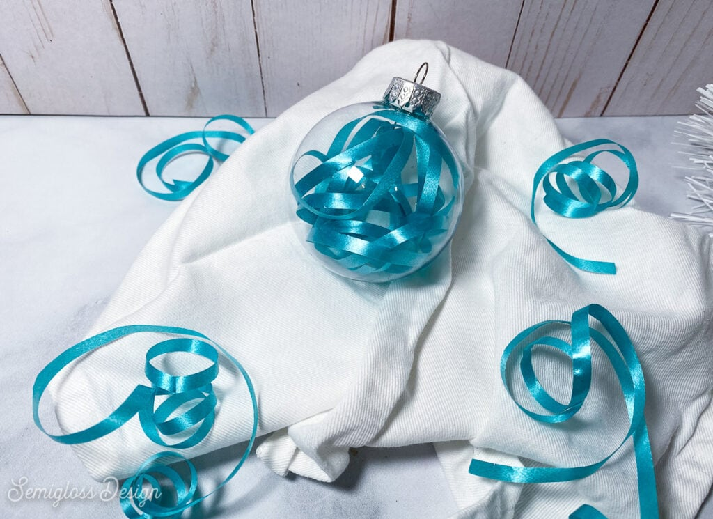 ornament filled with blue curling ribbon