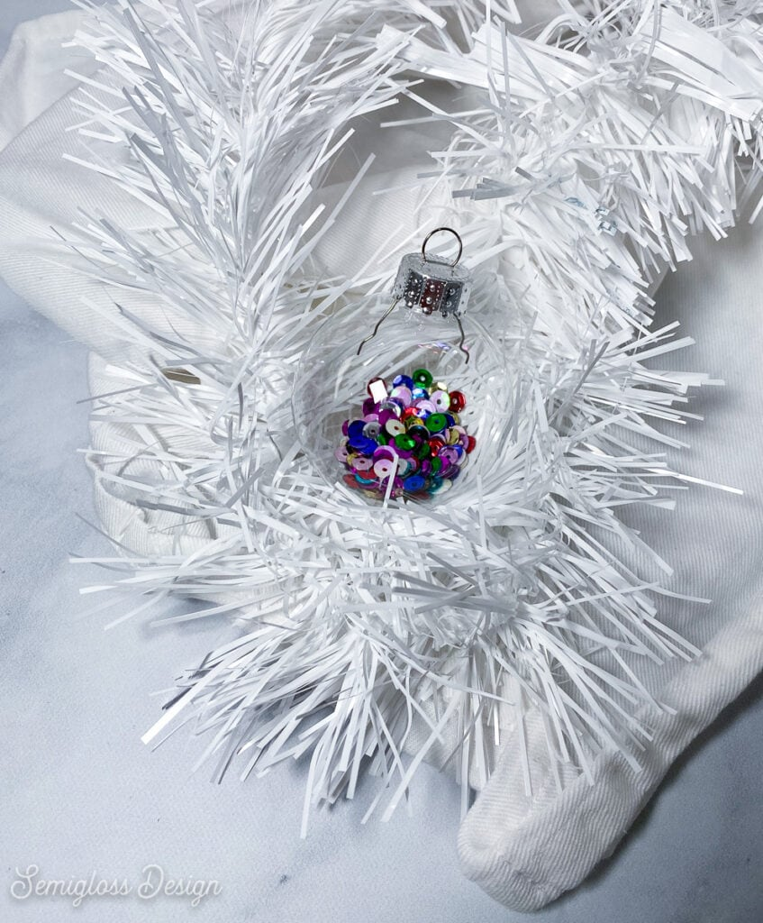 ornament filled with colorful sequins