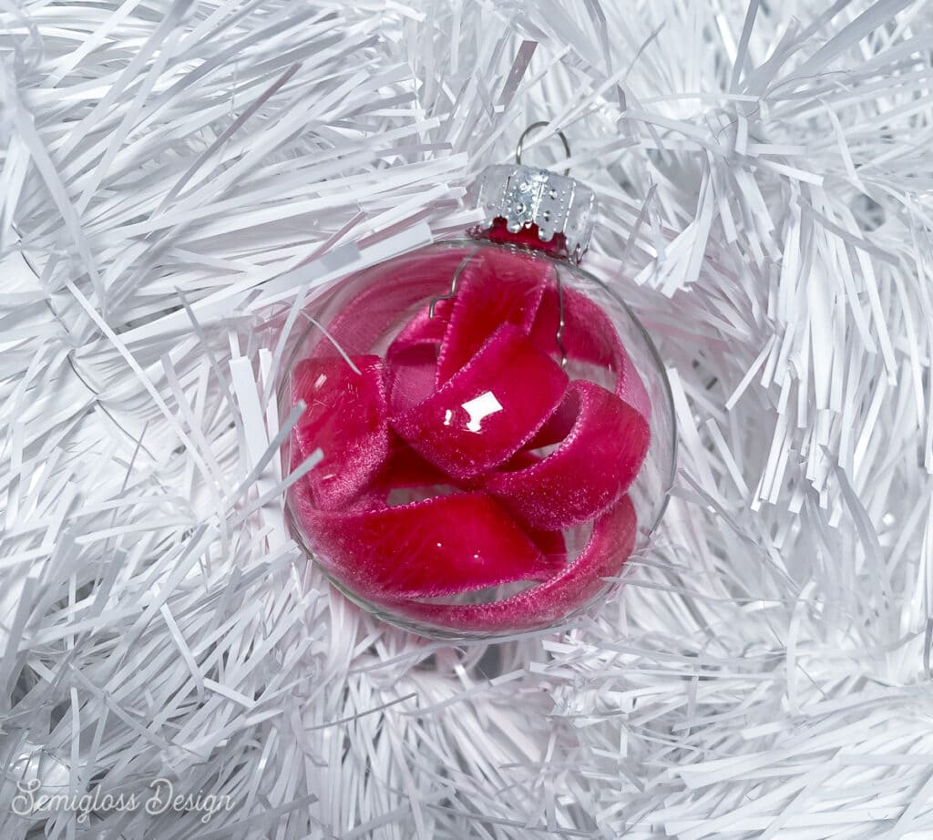 clear glass ornament with pink velvet ribbon