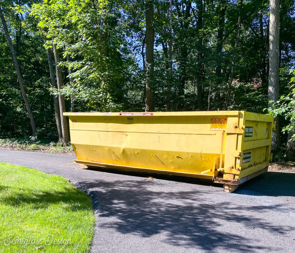 yellow dumpster in driveway