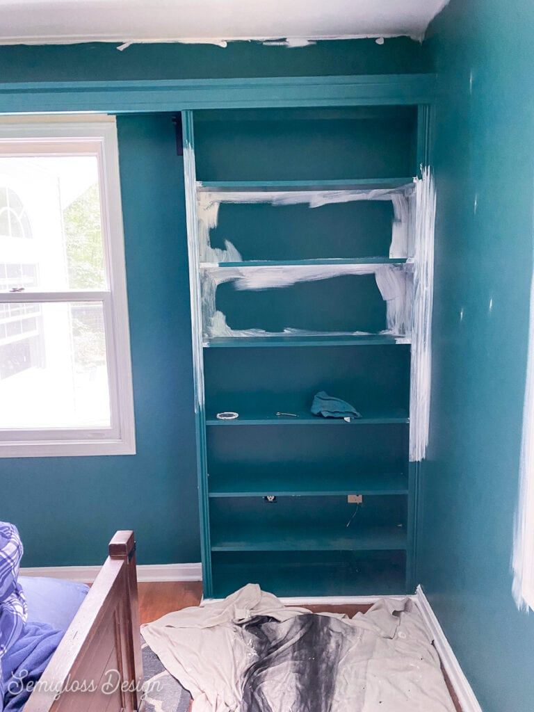 dark green room getting painted white