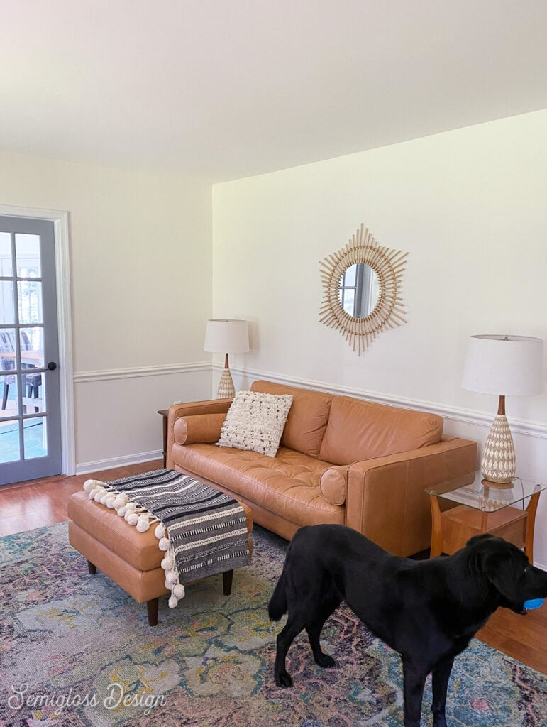 living room with tan leather sofa