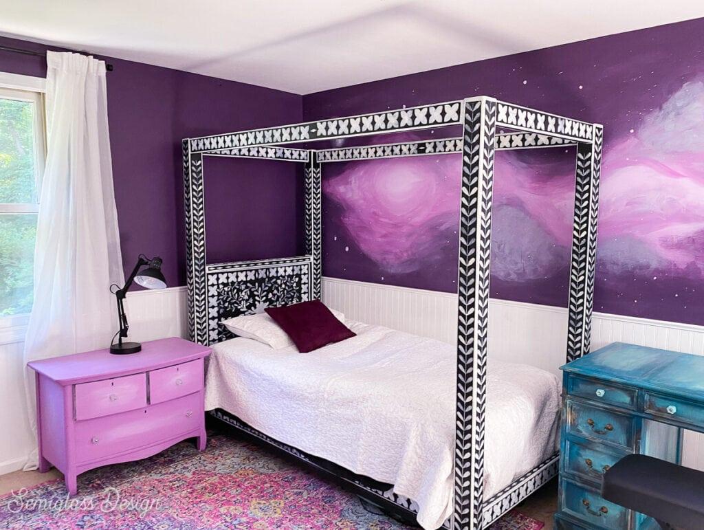 purple bedroom with white bedding