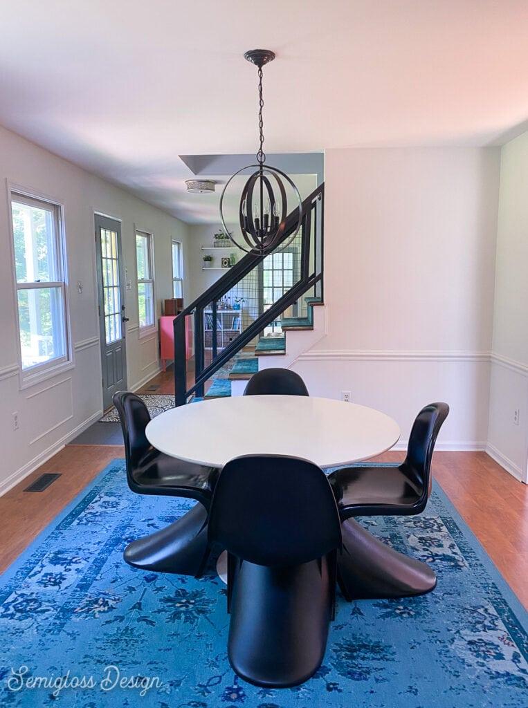 modern dining table on blue rug