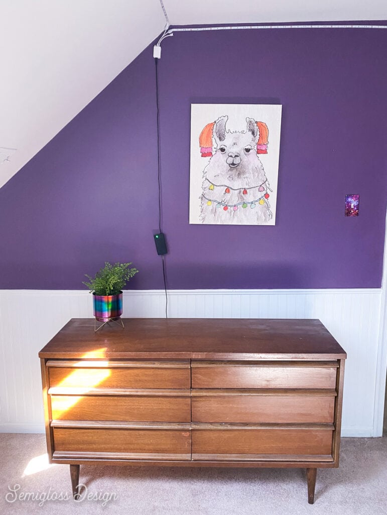 mcm dress in room with purple walls
