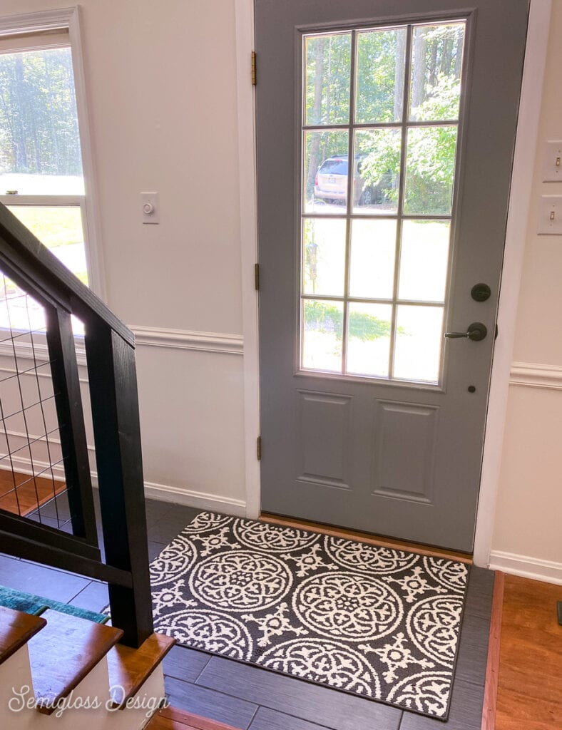 black and white rug in front entryway