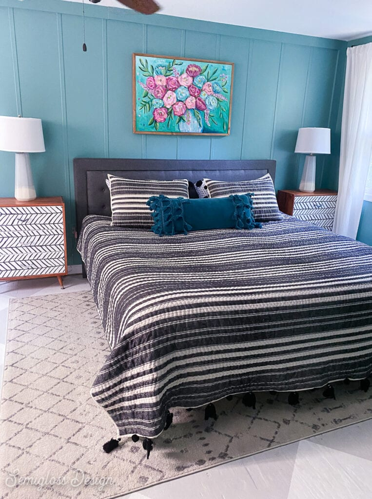 master bedroom with teal walls and black and white bedding