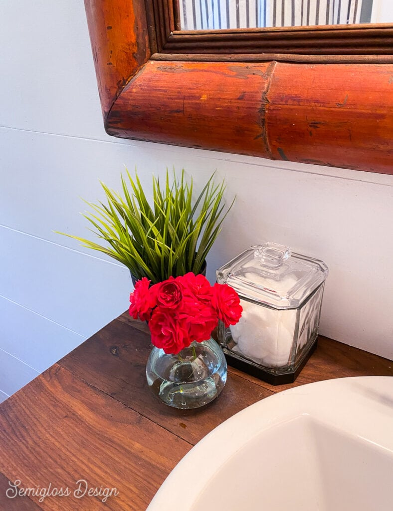small vase of roses in bathroom