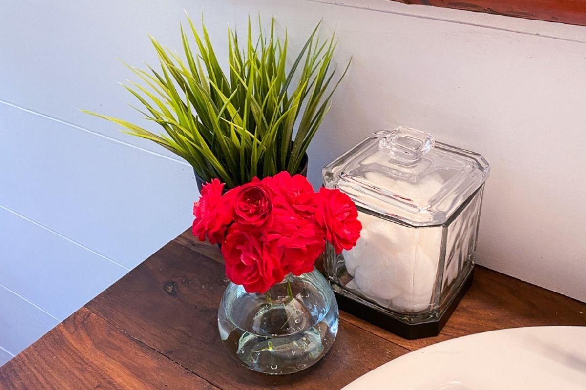 small vase with red roses