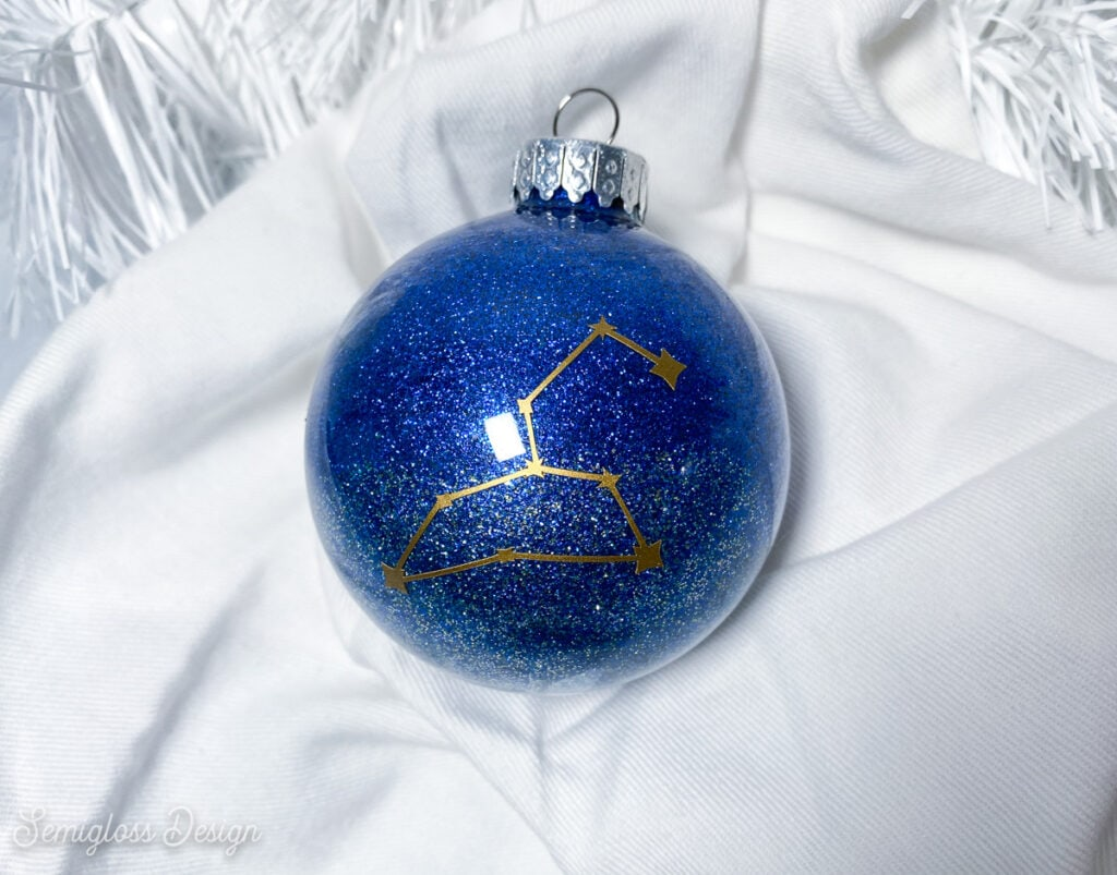 blue glitter galaxy ornament with Leo constellation decal